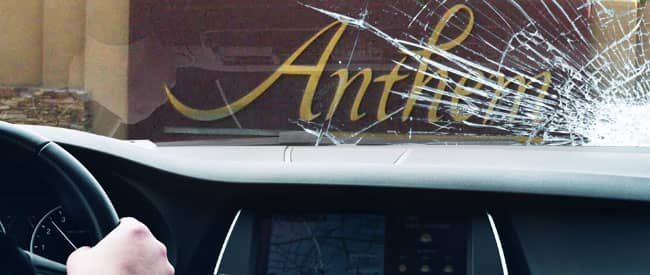 View of Anthem sign from inside a car, looking through a severely-cracked windshield
