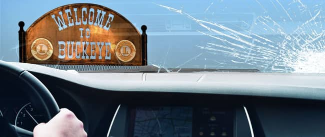 View of Buckeye sign from inside a car, looking through a severely-cracked windshield