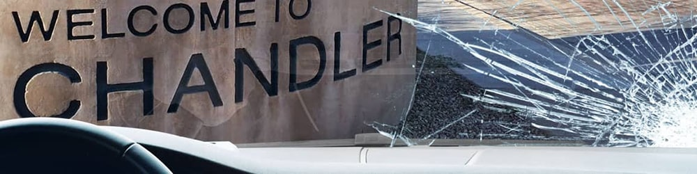 View of Chandler sign from inside a car, looking through a severely-cracked windshield