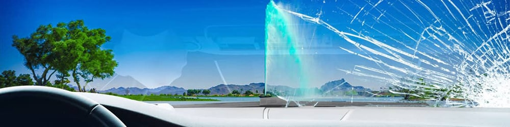 View of Fountain Hills sign from inside a car, looking through a severely-cracked windshield