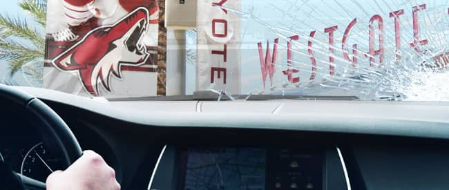 View of Glendale sign from inside a car, looking through a severely-cracked windshield