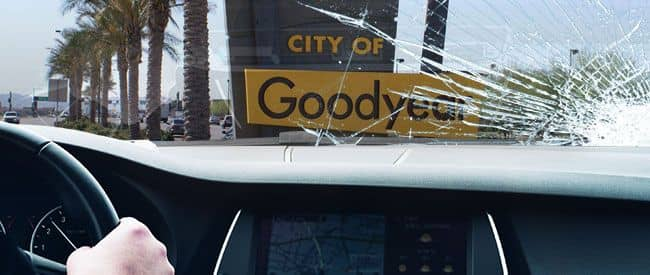 View of Goodyear sign from inside a car, looking through a severely-cracked windshield