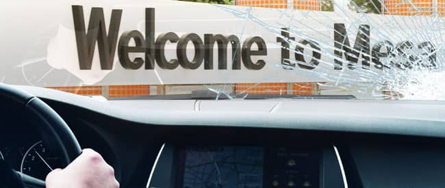View of Mesa sign from inside a car, looking through a severely-cracked windshield
