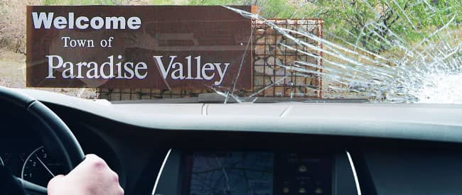 View of Paradise Valley sign from inside a car, looking through a severely-cracked windshield
