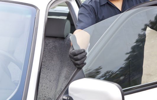Door rear window glass service all passenger vehicles man replacing car door window glass planetlyrics Image collections