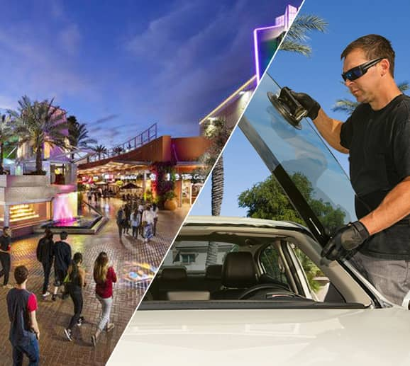 Mobile auto glass technician replacing a windshield at Tempe Marketplace in Tempe, AZ